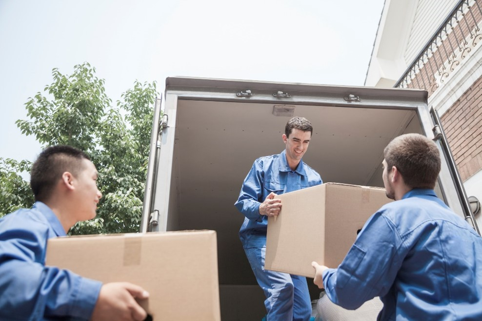 movers safely unloading a truck, following safety protocols