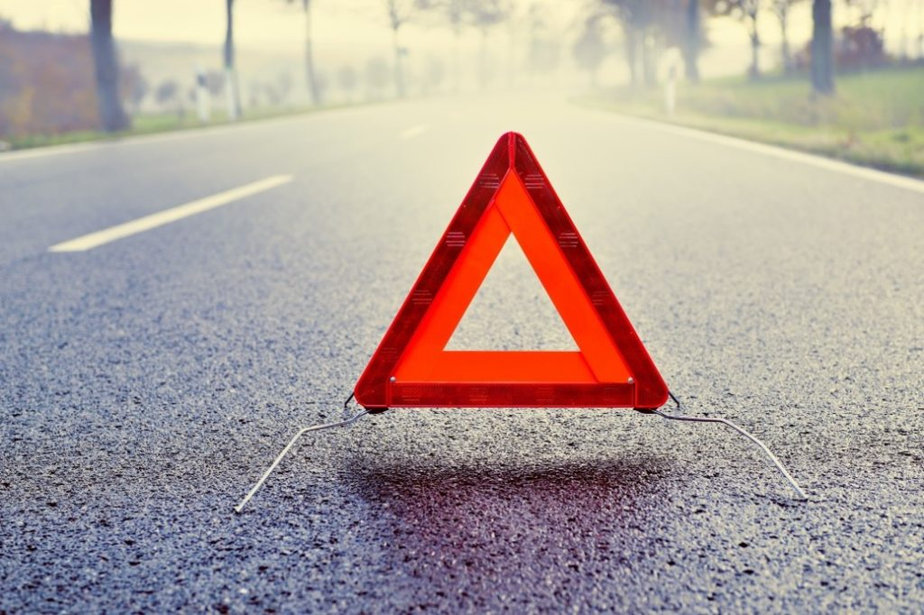place a warning sign on the road, a safety protocol for movers